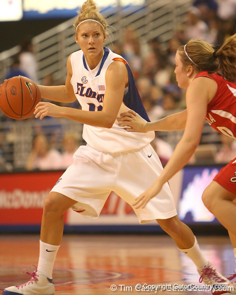 photo by Tim Casey<br /> <br /> Florida junior guard Steffi Sorensen dribbles around the arc during the Gators' 61-45 win against the Georgia Bulldogs on Sunday, January 18, 2009 at the Stephen C. O'Connell Center in Gainesville, Fla.