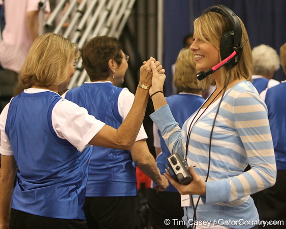 photo by Tim Casey<br /> <br /> Dazzlers coach Amber Kozinski congratulates the Golden Gators after a halftime performance during the Gators' 61-45 win against the Georgia Bulldogs on Sunday, January 18, 2009 at the Stephen C. O'Connell Center in Gainesville, Fla.