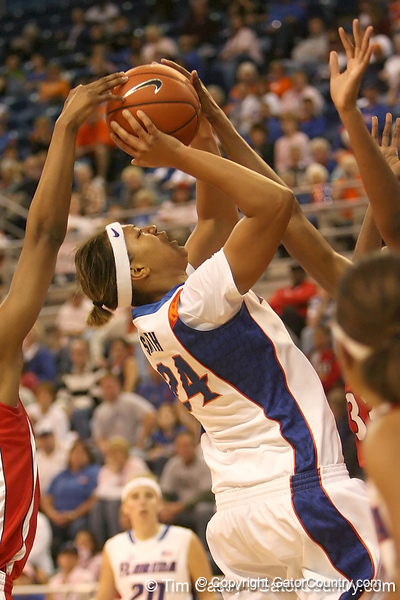 photo by Tim Casey<br /> <br /> Florida junior forward Sharielle Smith has her shot blocked by Angel Robinson during the Gators' 61-45 win against the Georgia Bulldogs on Sunday, January 18, 2009 at the Stephen C. O'Connell Center in Gainesville, Fla.