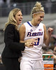 photo by Tim Casey<br /> <br /> Florida head coach Amanda Butler laughs as junior guard Steffi Sorensen checks out of the game during the Gators' 61-45 win against the Georgia Bulldogs on Sunday, January 18, 2009 at the Stephen C. O'Connell Center in Gainesville, Fla.