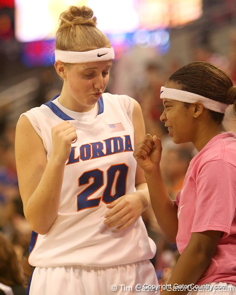 photo by Tim Casey<br /> <br /> Florida junior guard Susan Yenser bumps her first with junior guard Lonnika Thompson during the Gators' 61-45 win against the Georgia Bulldogs on Sunday, January 18, 2009 at the Stephen C. O'Connell Center in Gainesville, Fla.