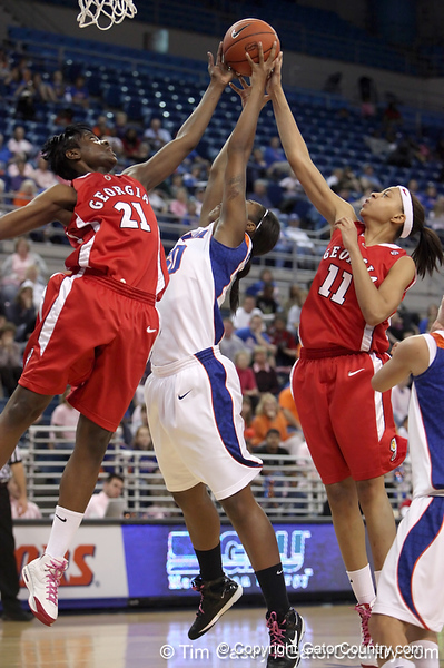 photo by Tim Casey<br /> <br /> Florida sophomore center Ebonie Crawford commits a foul while reaching for a rebound during the Gators' 61-45 win against the Georgia Bulldogs on Sunday, January 18, 2009 at the Stephen C. O'Connell Center in Gainesville, Fla.