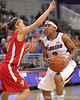 photo by Tim Casey<br /> <br /> Florida junior guard Lonnika Thompson scores on a layup after getting  fouled by Ashley Houts during the Gators' 61-45 win against the Georgia Bulldogs on Sunday, January 18, 2009 at the Stephen C. O'Connell Center in Gainesville, Fla.