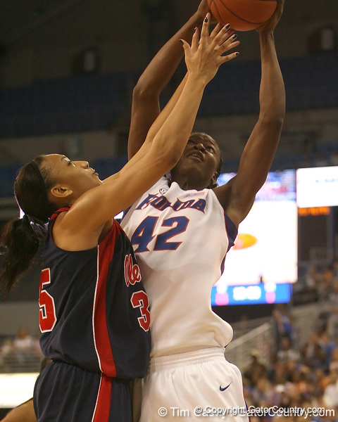 photo by Tim Casey<br /> <br /> Florida senior center Aneika Henry attempts to grab a rebound during the Gators' 75-54 win against the Mississippi Rebels on Sunday, January 25, 2009 at the Stephen C. O'Connell Center in Gainesville, Fla.