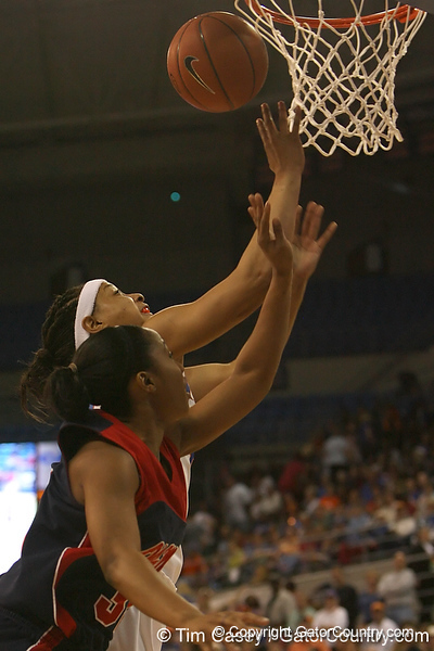 photo by Tim Casey<br /> <br /> Florida senior forward Marshae Dotson reaches for a rebound during the Gators' 75-54 win against the Mississippi Rebels on Sunday, January 25, 2009 at the Stephen C. O'Connell Center in Gainesville, Fla.
