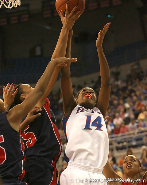 photo by Tim Casey<br /> <br /> Florida redshirt-freshman forward Ndidi Madu reaches for a rebound during the Gators' 75-54 win against the Mississippi Rebels on Sunday, January 25, 2009 at the Stephen C. O'Connell Center in Gainesville, Fla.
