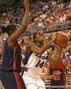 photo by Tim Casey<br /> <br /> Florida redshirt-freshman forward Ndidi Madu grabs an offensive rebound with 5:58 remaining during the first half of the Gators' 75-54 win against the Mississippi Rebels on Sunday, January 25, 2009 at the Stephen C. O'Connell Center in Gainesville, Fla.