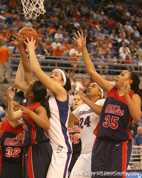 photo by Tim Casey<br /> <br /> Florida freshman center Azania Stewart reaches for a rebound during the Gators' 75-54 win against the Mississippi Rebels on Sunday, January 25, 2009 at the Stephen C. O'Connell Center in Gainesville, Fla.