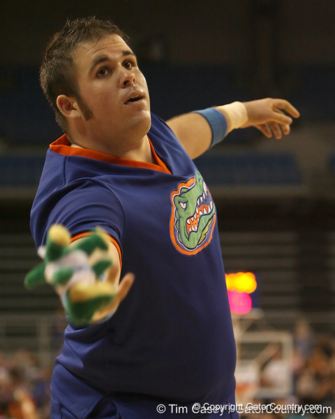 photo by Tim Casey<br /> <br /> A Florida cheerleader tosses a stuffed animal to the crowd during the Gators' 75-54 win against the Mississippi Rebels on Sunday, January 25, 2009 at the Stephen C. O'Connell Center in Gainesville, Fla.