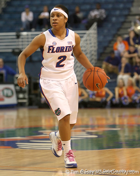 photo by Tim Casey<br /> <br /> Florida junior guard Lonnika Thompson dribbles the ball around the arc during the second half of the Gators' 74-59 win against the Kentucky Wildcats on Thursday, January 29, 2009 at the Stephen C. O'Connell Center in Gainesville, Fla.