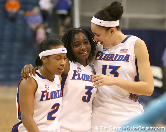 photo by Tim Casey<br /> <br /> Florida junior guard Lonnika Thompson, senior guard Sha Brooks and freshman center Azania Stewart walk off of the court after the Gators' 74-59 win against the Kentucky Wildcats on Thursday, January 29, 2009 at the Stephen C. O'Connell Center in Gainesville, Fla.
