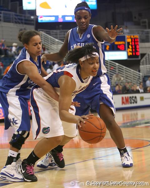 photo by Tim Casey<br /> <br /> Florida senior forward Marshae Dotson gets fouled during the second half of the Gators' 74-59 win against the Kentucky Wildcats on Thursday, January 29, 2009 at the Stephen C. O'Connell Center in Gainesville, Fla.