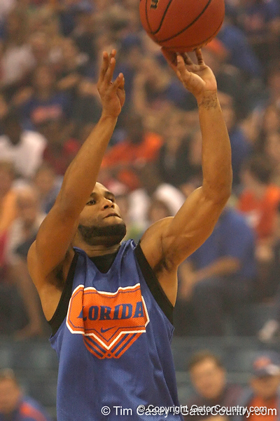 """photo by Tim Casey<br /> <br /> Walter Hodge shoots for a 3-point basket during """"Shooting With the Stars,"""" a basketball fan appreciation event, on Friday, October 24, 2008 at the Stephen C. O'Connell Center in Gainesville, Fla."""