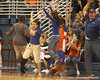 "photo by Tim Casey<br /> <br /> Fans celebrate a victory in a relay contest during ""Shooting With the Stars,"" a basketball fan appreciation event, on Friday, October 24, 2008 at the Stephen C. O'Connell Center in Gainesville, Fla."
