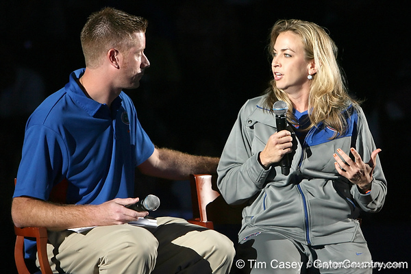 "photo by Tim Casey<br /> <br /> Jeff Cardozo speaks with UF women's basketball head coach Amanda Butler during ""Shooting With the Stars,"" a basketball fan appreciation event, on Friday, October 24, 2008 at the Stephen C. O'Connell Center in Gainesville, Fla."