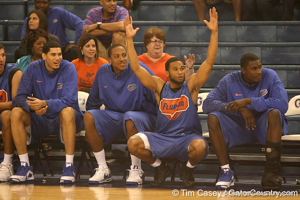 """photo by Tim Casey<br /> <br /> Walter Hodge watches Erving Walker shoot a halfcourt shot during """"Shooting With the Stars,"""" a basketball fan appreciation event, on Friday, October 24, 2008 at the Stephen C. O'Connell Center in Gainesville, Fla."""