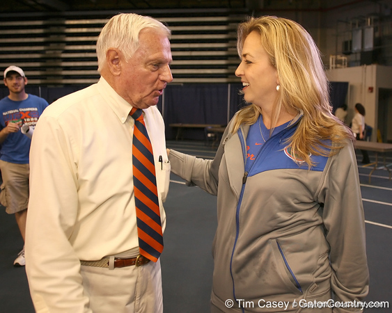 """photo by Tim Casey<br /> <br /> Mr. Two Bits speaks with UF women's basketball head coach Amanda Butler during """"Shooting With the Stars,"""" a basketball fan appreciation event, on Friday, October 24, 2008 at the Stephen C. O'Connell Center in Gainesville, Fla."""