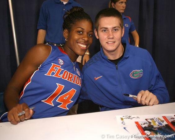 """photo by Tim Casey<br /> <br /> Ndidi Madu and Kyle McClanahan sign autographs during """"Shooting With the Stars,"""" a basketball fan appreciation event, on Friday, October 24, 2008 at the Stephen C. O'Connell Center in Gainesville, Fla."""