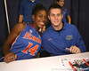 "photo by Tim Casey<br /> <br /> Ndidi Madu and Kyle McClanahan sign autographs during ""Shooting With the Stars,"" a basketball fan appreciation event, on Friday, October 24, 2008 at the Stephen C. O'Connell Center in Gainesville, Fla."