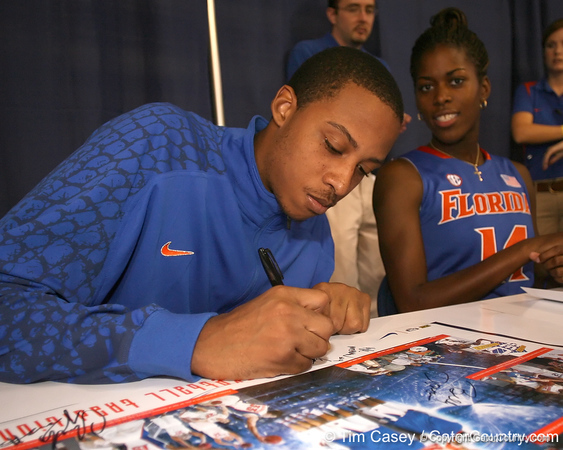 """photo by Tim Casey<br /> <br /> Kenny Kadji signs autographs during """"Shooting With the Stars,"""" a basketball fan appreciation event, on Friday, October 24, 2008 at the Stephen C. O'Connell Center in Gainesville, Fla."""