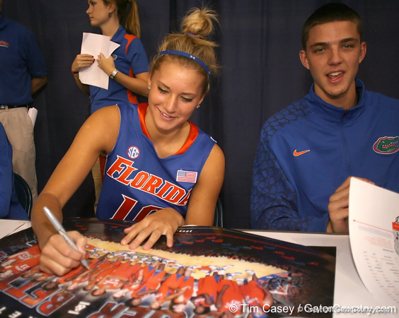 """photo by Tim Casey<br /> <br /> Steffi Sorensen signs autographs during """"Shooting With the Stars,"""" a basketball fan appreciation event, on Friday, October 24, 2008 at the Stephen C. O'Connell Center in Gainesville, Fla."""