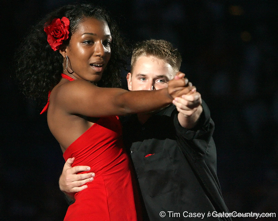 """photo by Tim Casey<br /> <br /> Ebonie Crawford and cheerleader Travis Ownes perform during """"Shooting With the Stars,"""" a basketball fan appreciation event, on Friday, October 24, 2008 at the Stephen C. O'Connell Center in Gainesville, Fla."""