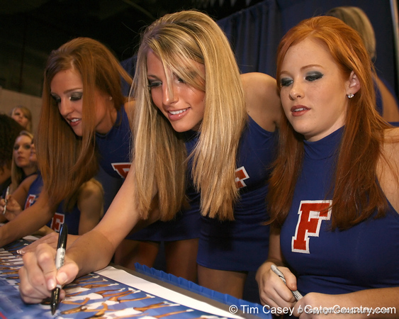 "photo by Tim Casey<br /> <br /> Florida Dazzlers sign autographs during ""Shooting With the Stars,"" a basketball fan appreciation event, on Friday, October 24, 2008 at the Stephen C. O'Connell Center in Gainesville, Fla."