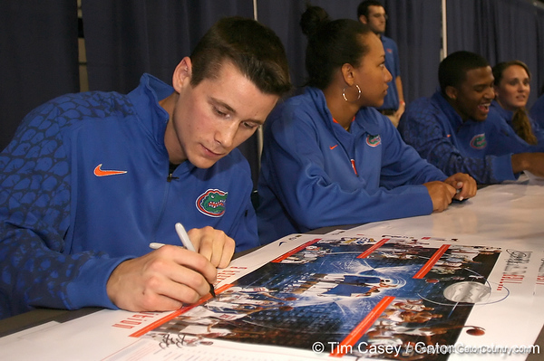 """photo by Tim Casey<br /> <br /> Hudson Fricke signs autographs during """"Shooting With the Stars,"""" a basketball fan appreciation event, on Friday, October 24, 2008 at the Stephen C. O'Connell Center in Gainesville, Fla."""