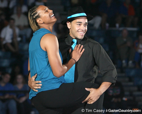"""photo by Tim Casey<br /> <br /> Sharielle Smith performs with cheerleader Darwin Rivera during """"Shooting With the Stars,"""" a basketball fan appreciation event, on Friday, October 24, 2008 at the Stephen C. O'Connell Center in Gainesville, Fla."""