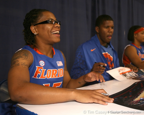"""photo by Tim Casey<br /> <br /> Kim Critton signs autographs during """"Shooting With the Stars,"""" a basketball fan appreciation event, on Friday, October 24, 2008 at the Stephen C. O'Connell Center in Gainesville, Fla."""