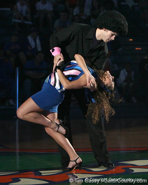 "photo by Tim Casey<br /> <br /> Nick Calathes and Dazzler Amy Cotnoir perform during ""Shooting With the Stars,"" a basketball fan appreciation event, on Friday, October 24, 2008 at the Stephen C. O'Connell Center in Gainesville, Fla."