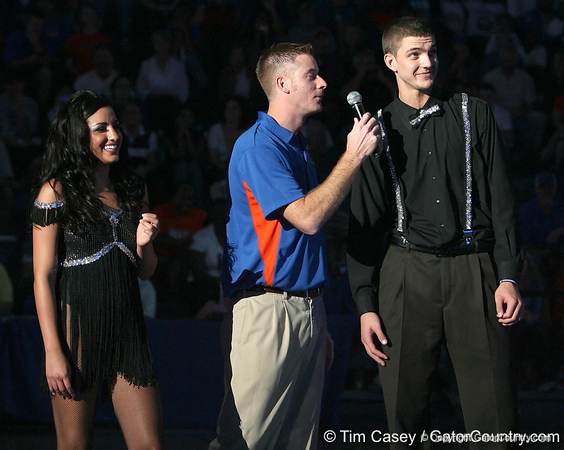 "photo by Tim Casey<br /> <br /> Chandler Parsons and Dazzler Lea Palumbo perform during ""Shooting With the Stars,"" a basketball fan appreciation event, on Friday, October 24, 2008 at the Stephen C. O'Connell Center in Gainesville, Fla."