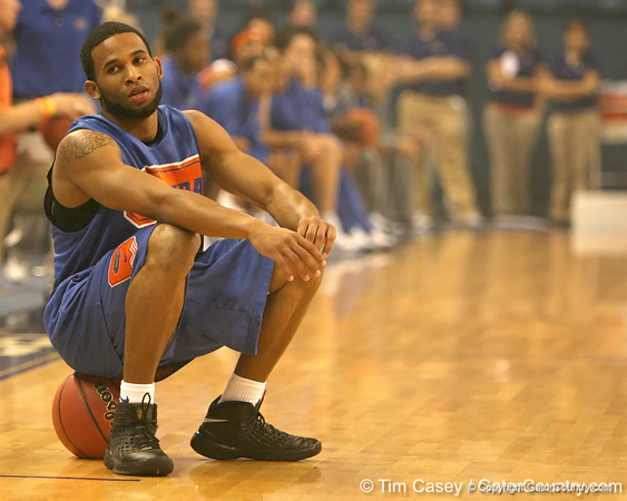 """photo by Tim Casey<br /> <br /> Walter Hodge takes a break during """"Shooting With the Stars,"""" a basketball fan appreciation event, on Friday, October 24, 2008 at the Stephen C. O'Connell Center in Gainesville, Fla."""