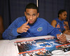 "photo by Tim Casey<br /> <br /> Walter Hodge signs autographs during ""Shooting With the Stars,"" a basketball fan appreciation event, on Friday, October 24, 2008 at the Stephen C. O'Connell Center in Gainesville, Fla."