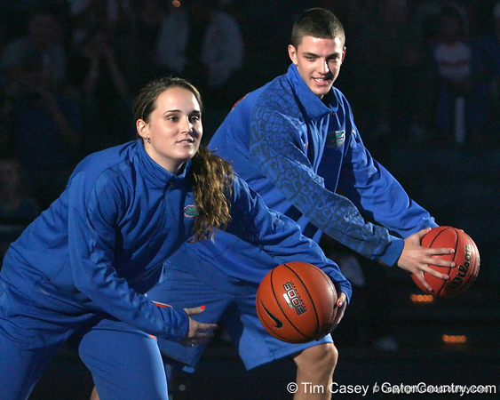 """photo by Tim Casey<br /> <br /> Jennifer Mossor and Chandler Parsons perform during """"Shooting With the Stars,"""" a basketball fan appreciation event, on Friday, October 24, 2008 at the Stephen C. O'Connell Center in Gainesville, Fla."""