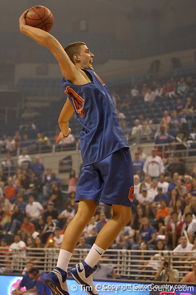 """photo by Tim Casey<br /> <br /> Chandler Parsons goes up for a slam dunk during """"Shooting With the Stars,"""" a basketball fan appreciation event, on Friday, October 24, 2008 at the Stephen C. O'Connell Center in Gainesville, Fla."""