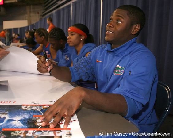 """photo by Tim Casey<br /> <br /> Erving Walker signs autographs during """"Shooting With the Stars,"""" a basketball fan appreciation event, on Friday, October 24, 2008 at the Stephen C. O'Connell Center in Gainesville, Fla."""