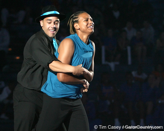 "photo by Tim Casey<br /> <br /> Sharielle Smith performs with cheerleader Darwin Rivera during ""Shooting With the Stars,"" a basketball fan appreciation event, on Friday, October 24, 2008 at the Stephen C. O'Connell Center in Gainesville, Fla."