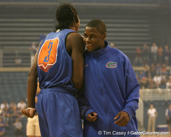 "photo by Tim Casey<br /> <br /> Ray Shipman celebrates with Erving Walker during ""Shooting With the Stars,"" a basketball fan appreciation event, on Friday, October 24, 2008 at the Stephen C. O'Connell Center in Gainesville, Fla."