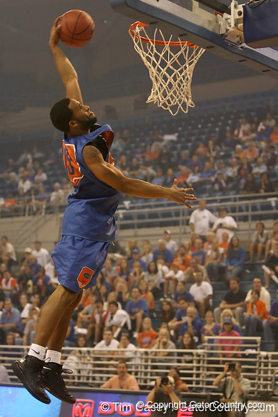 """photo by Tim Casey<br /> <br /> Walter Hodge goes up for a slam dunk during """"Shooting With the Stars,"""" a basketball fan appreciation event, on Friday, October 24, 2008 at the Stephen C. O'Connell Center in Gainesville, Fla."""