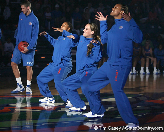 """photo by Tim Casey<br /> <br /> Jennifer Mossor dances during """"Shooting With the Stars,"""" a basketball fan appreciation event, on Friday, October 24, 2008 at the Stephen C. O'Connell Center in Gainesville, Fla."""