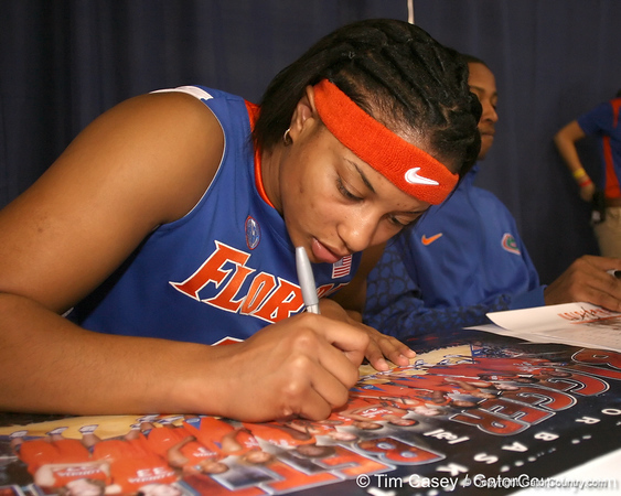 """photo by Tim Casey<br /> <br /> Marshae Dotson signs autographs during """"Shooting With the Stars,"""" a basketball fan appreciation event, on Friday, October 24, 2008 at the Stephen C. O'Connell Center in Gainesville, Fla."""