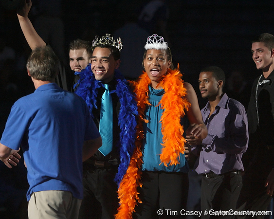 """photo by Tim Casey<br /> <br /> Sharielle Smith and cheerleader Darwin Rivera are crowned as champions during """"Shooting With the Stars,"""" a basketball fan appreciation event, on Friday, October 24, 2008 at the Stephen C. O'Connell Center in Gainesville, Fla."""