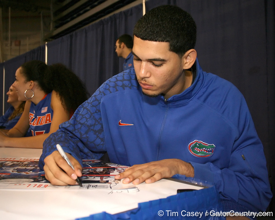 """photo by Tim Casey<br /> <br /> Florida freshman Eloy Vargas signs autographs during """"Shooting With the Stars,"""" a basketball fan appreciation event, on Friday, October 24, 2008 at the Stephen C. O'Connell Center in Gainesville, Fla."""