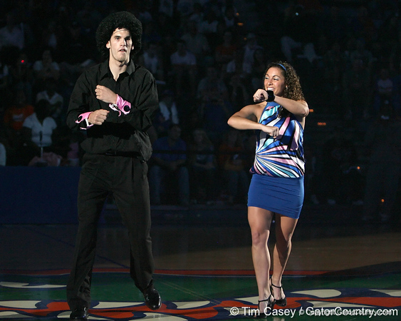 """photo by Tim Casey<br /> <br /> Nick Calathes and Dazzler Amy Cotnoir perform during """"Shooting With the Stars,"""" a basketball fan appreciation event, on Friday, October 24, 2008 at the Stephen C. O'Connell Center in Gainesville, Fla."""