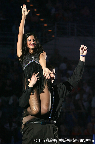 """photo by Tim Casey<br /> <br /> Chandler Parsons and Dazzler Lea Palumbo perform during """"Shooting With the Stars,"""" a basketball fan appreciation event, on Friday, October 24, 2008 at the Stephen C. O'Connell Center in Gainesville, Fla."""