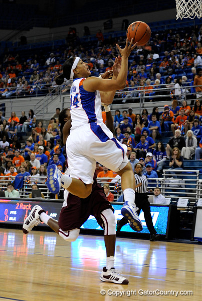 (Casey Brooke Lawson / Gator Country) UF forward Marshae Dotson moves the ball past a Mississippi State player during the Gators game against the Lady Bulldogs in Gainesville, Fla., on January 8, 2009.