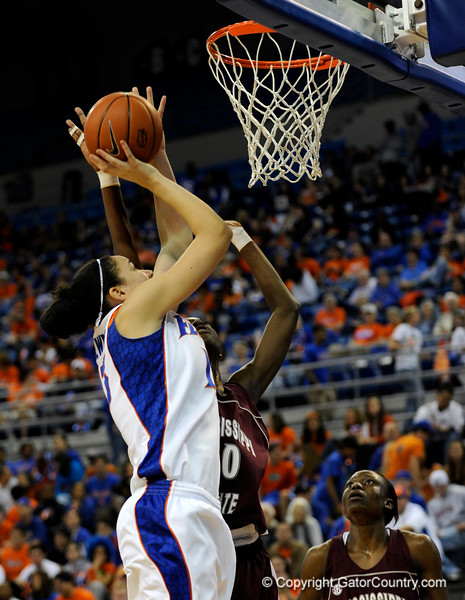 (Casey Brooke Lawson / Gator Country) UF center Azania Stewart moves the ball past a Mississippi State player during the Gators game against the Lady Bulldogs in Gainesville, Fla., on January 8, 2009.