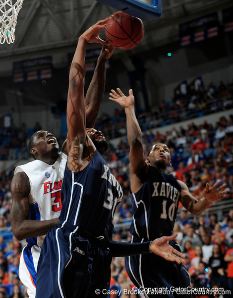 University of Florida center Vernon Macklin blocks two Xavier players from getting a rebound during the Gators 64-76 loss to the Musketeers in Gainesville, Fla., on Saturday, February 13, 2010. / Gator Country photo by Casey Brooke Lawson
