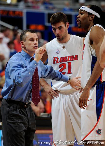 University of Florida Head Coach Billy Donovan speaks to forward Dan Werner and forward Alex Tyus during the Gators 64-76 loss to the Musketeers in Gainesville, Fla., on Saturday, February 13, 2010. / Gator Country photo by Casey Brooke Lawson